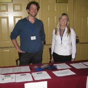 Two volunteers, Travis Sagedahl & Kendra Gilbertson, working at an information booth during a rehearsal