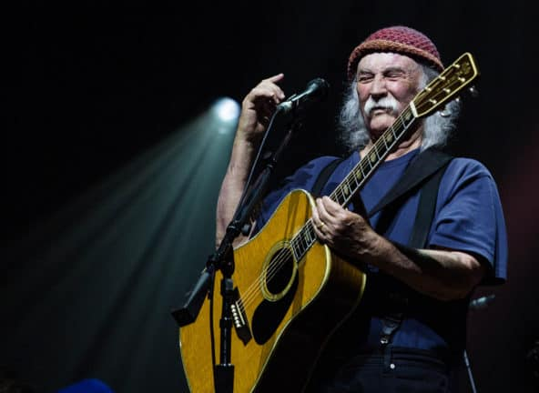 David Crosby playing acoustic guitar